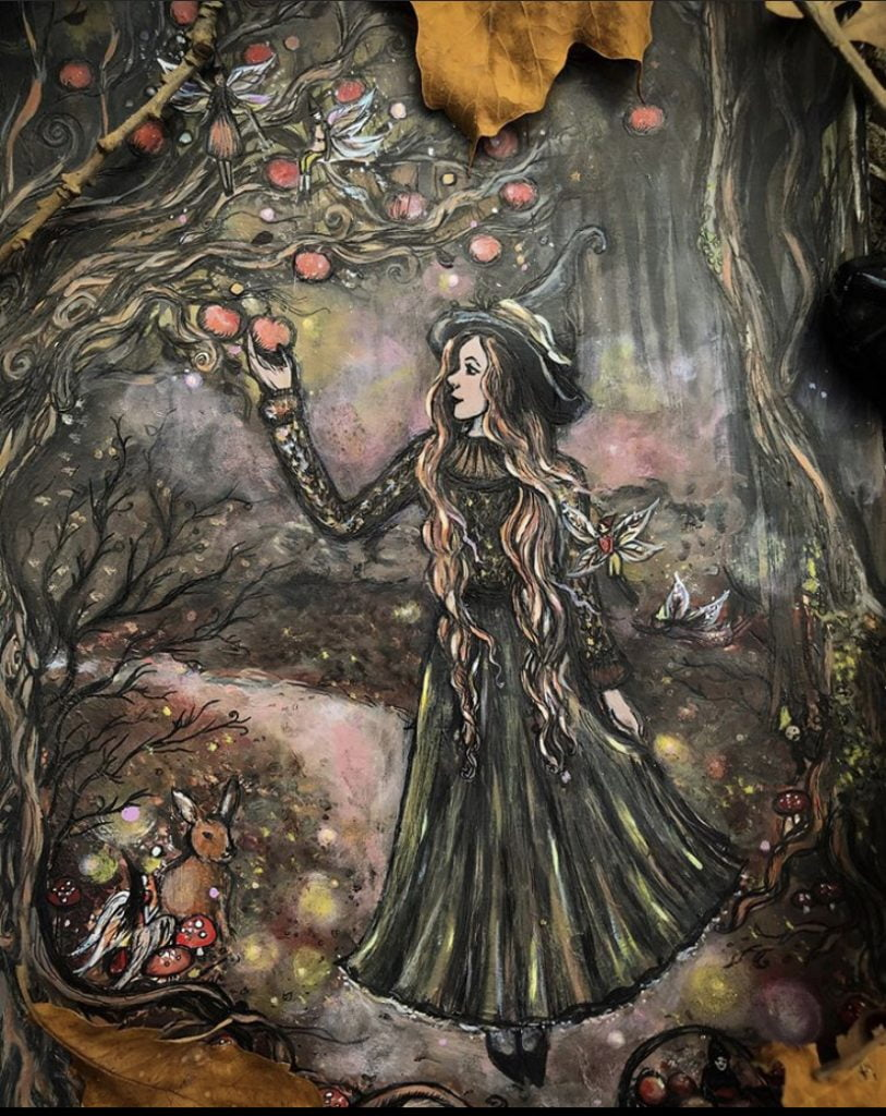 A beautiful image of a witch collecting apples by Lady Viktoria, who you can find at https://www.etsy.com/shop/artbyladyviktoria and @ladytor